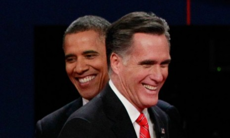 president-obama-and-gop-nominee-mitt-romney-share-a-laugh-during-the-first-presidential-debate-on
