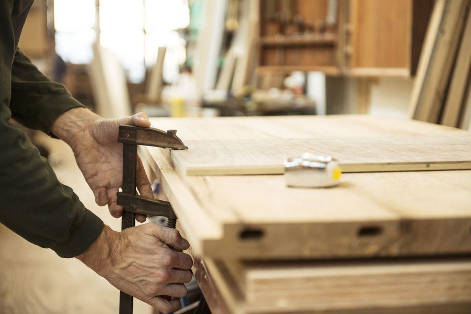 man-clamping-wood-542744879-57cf0fde3df78c71b67653ca